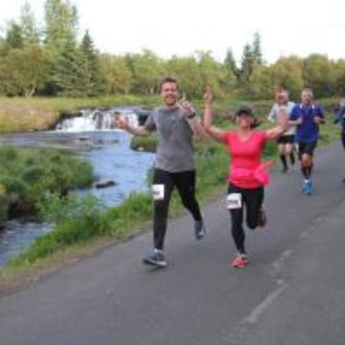 Runners by river Elliðaár