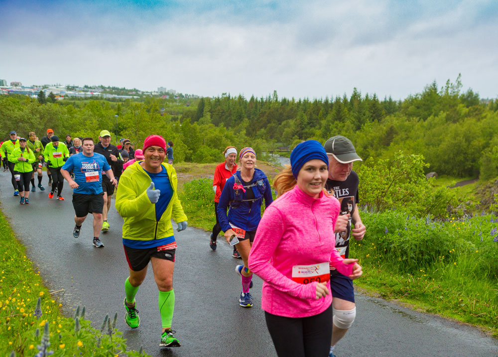 Happy participants running in Elliðaárdalur valley