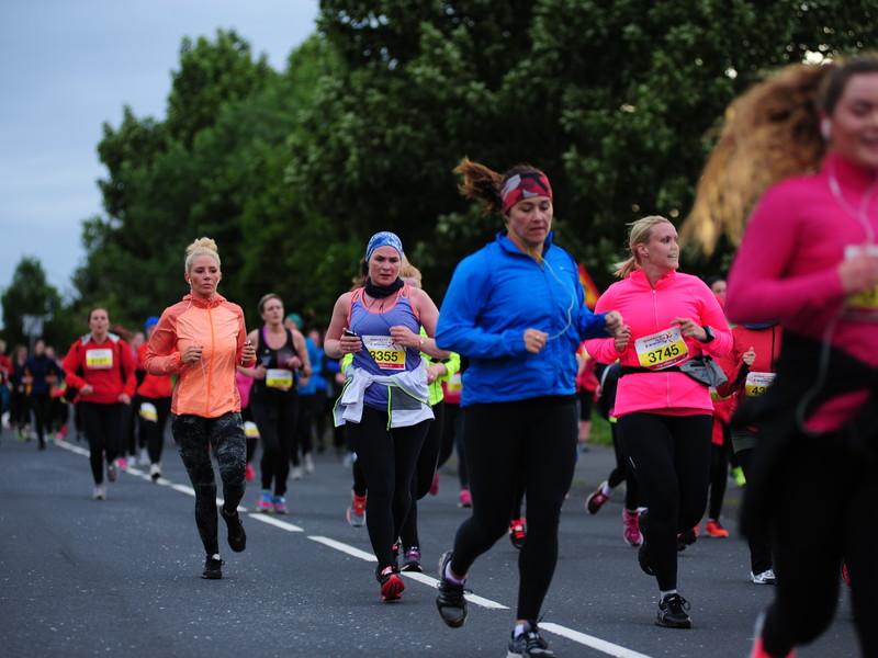 5 km participants running down street Engjavegur
