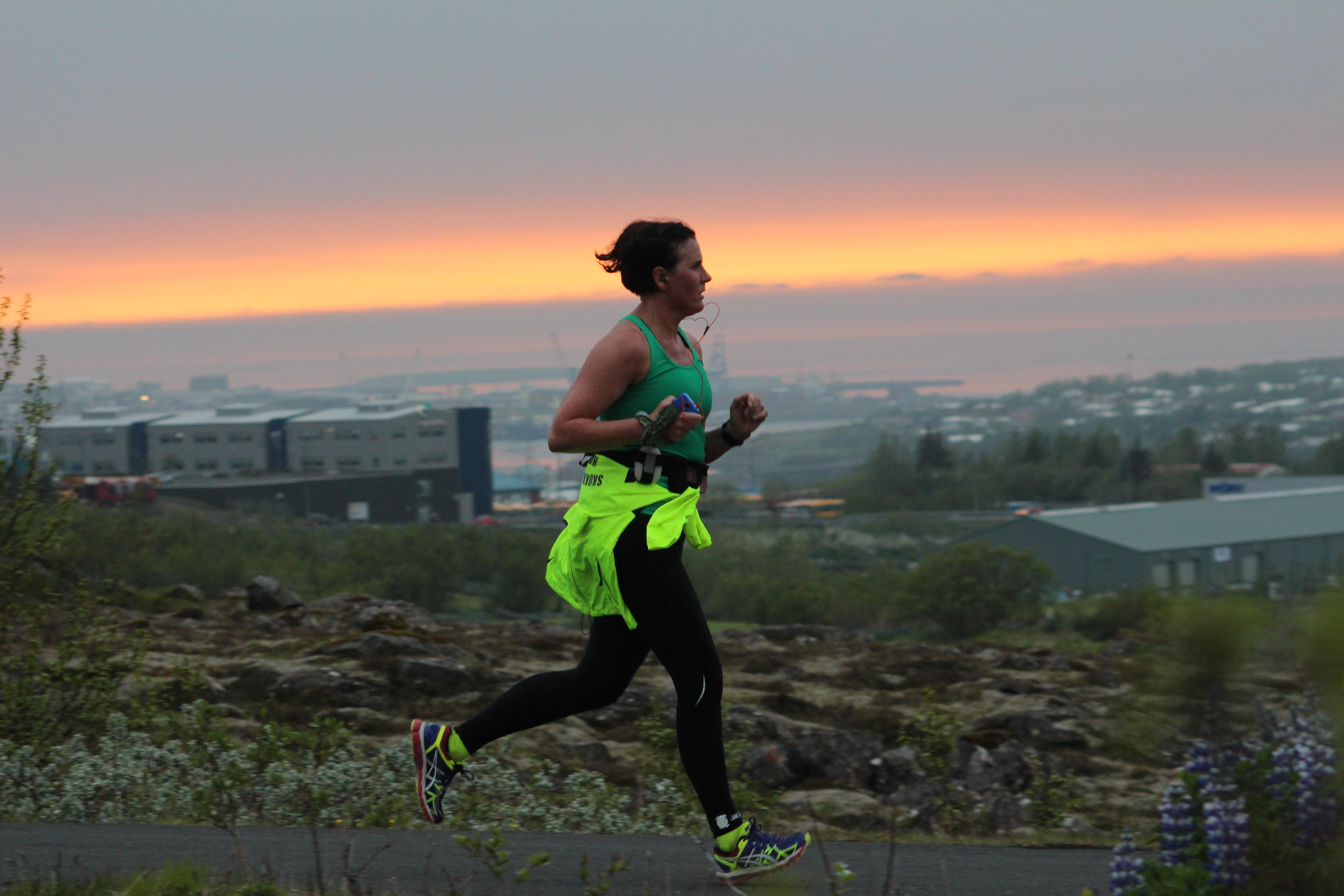 Woman running in the midnight sun