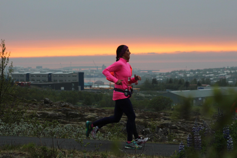 Two women running in the midnight sun